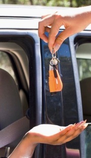 people handing over car keys with resqme quick car escape tool (image. resqme.com)
