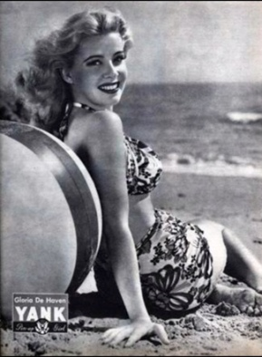 Woman in bathing suit on beach with Bech ball. Gloria DeHaven, 1945 Yank, the Army Weekly. (USPD. pub.date, artist life, by fed employee/