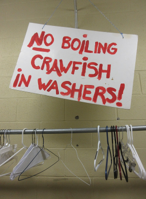 Warning sign of a laundry concerning crawfish cleaning using their washers. Lafayette, Louisiana, 2017. released to free use by author/Infrogmation of New Orleans/Commons.wikimedia.org)
