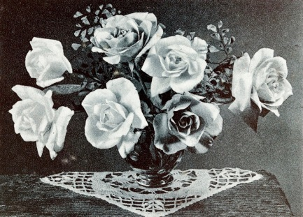 Vintage roses in vase with crochet doily (1943 Mother's Day greeting card/USPD.pub.date, artist life/Commons.wikimedia.org)