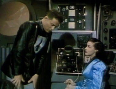 Man and woman in space ship at console.1951 Flight to Mars (USPD. pub.date, artist life/Commons.wikimedia.org)