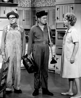 Two men and a woman. 1964. The Lucy Show with Bob Hope as a plumber, Jack Benny as his assistant, and Lucille Ball. CBS (USPD.pub.date, artist life/Commons.wikimedia.org)