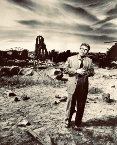 "Man in front of desolate area. Twilight Zone episode ""Time Enough at last"" 1960. TV promo/Bureau of Industrial Service (USPD. pub.date/artists life/Commons.wikimedia.org)"