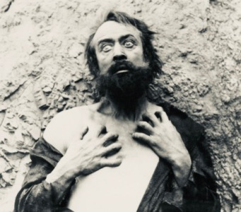 Man looking crazy. 1916. film about drug addict. (USPD. pub.date, artist life/COmmons.wikimedia.org)