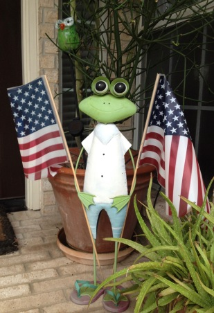 Frog in flip flops holding two American flags (© image. All rights reserved, copyrighted, NO permissions granted)