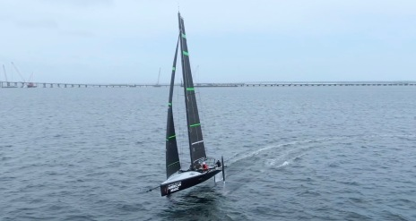 Sailboat flying full speed up on foils practicing for America's Cup (Screenshot The Sailing Show)