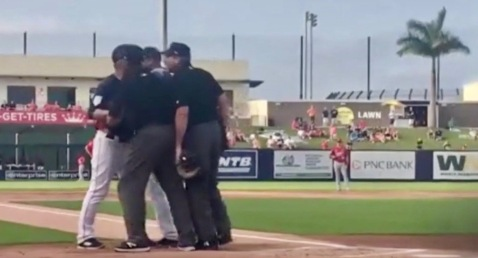 Skeeters' baseball players and umpires arguing. (Screenshot. click2houston)
