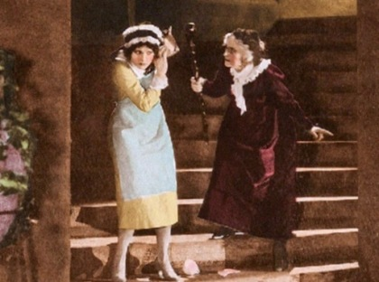 two women. 1921 film lobby card. (USPD. pub.date, artist life/Commons.wikimedia.org)