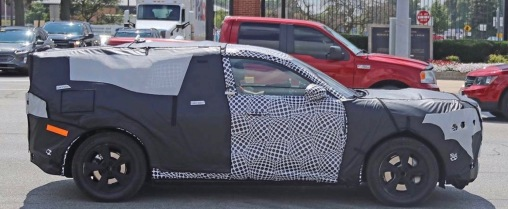Car. Ford Mustang inspired Mach E SUV in camo during testing. (Brian Williams photo/Fox Business)