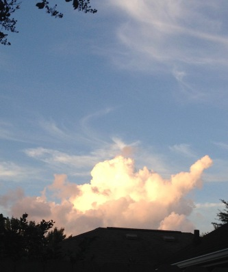 White and golden puffy cloud appearing over the house top. (© image. copyrighted, all rights reserved. NO permissions granted)