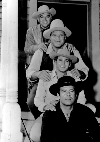 4 men in cowboy outfits. Cast of 1962 TV series Bonanza (NBC tv/sponsor Chevy pub. relations company (USPD. pub.date, pub.photo, artist life/Commons.wikimedia.org)