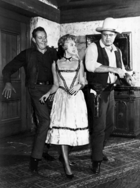 Three people in western dress dancing. Bonanza pub. photo by NBC1962 (USPD. pub.date, artist life/Commons.wikimedia.org)