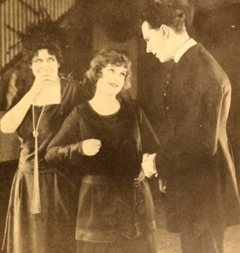Two woman talking to a man. 1920. (Film clip May Allison/Motion Picture Magazine/ USPD.pub.date, artist life/Commons.wikimedia.org)