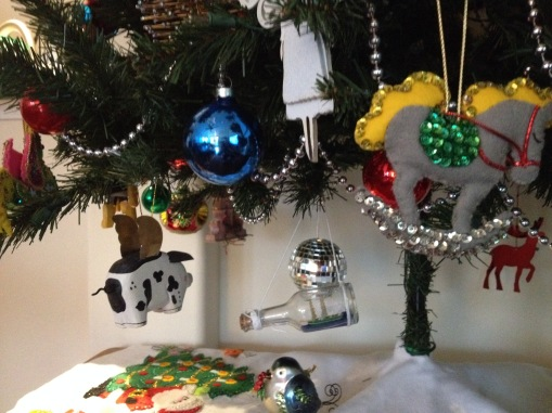 Flying pig and other Christmas ornaments on lower branches (© image: all rights reserved, copyrighted, NO permissions granted )