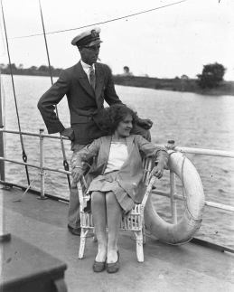 MAn and seated woman on large sailing vessel, 1929 (Hood Collection, Australian NAt.Maritime Museum, 1929/Commons.wikimedia.org)