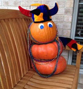 Pumpkin in Mardi Gras hat and beads (Pumpkins dressed for Mardi Gras in beads. ( image copyrighted, all rights reserved, no permissions granted)