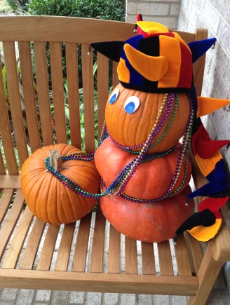 Two pumpkins ready for Mardi Gras parade in beads (Copyrighted, no permissions granted, all rights reserved)
