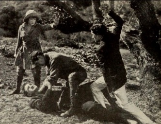 Woman stopping 3 men from fighting. May Allison in Island of Intrigue/Metro Pict.Corp. publicity pix for Exhibitors Merald, 1919. (USPD pub.date, artist life/Commons.wikimedia.org)