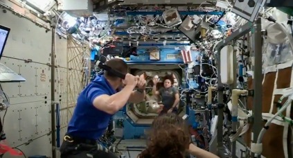 Astronauts playing baseball on Space Station (screenshot.USPD. NASA/Space.com)