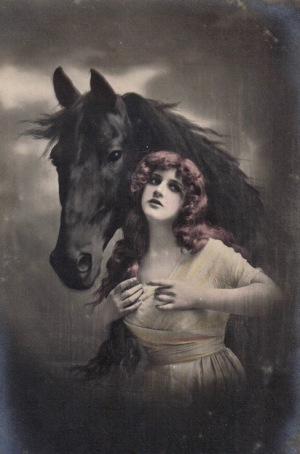 Woman and black horse. 1920 postcard (USPD. Artist life/pub.date; Commons.wikimedia.org)
