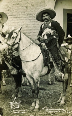 Mexican man on horse. 1912. (Mexican Revoltionary on postcard. SMU DeGolyer Lib.(USPD.artist life, pub.date/Commons.wikimedia.org)