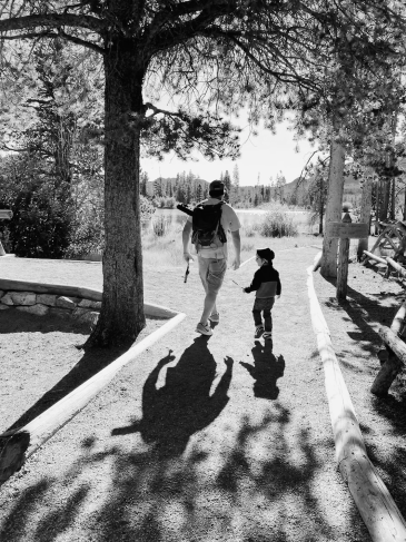 Man and child walking down path going fishing (© image. Copyrighted, No permissions granted, All rights reserved)