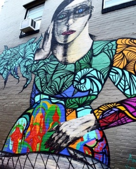 Woman in colorful dress. Street mural in Houston (Screenshot/KHOU)
