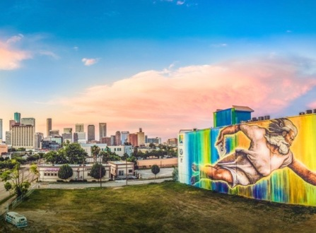 Divine Artist Houston street mural. God with a paint spray can (Screenshot/KHOU)