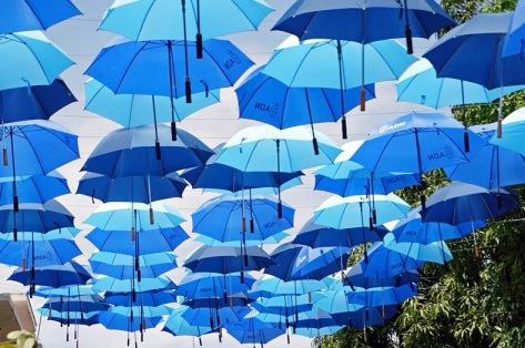 Many blue umbrellas floating overhead. (Mariordo/Commons.wikimedia.org)