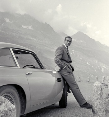 Sean Connery. 007 leaning agaisnt car (image: Official James Bond 007 website)