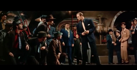 Group of men in vintage clothing. Marlon Brando. (Screenshot Guys and Dolls)