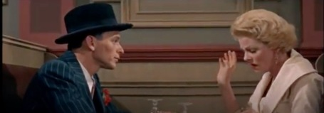 "Couple talking. Frank Sinatra (Nathan Detroit) and Vivian Blaine (Adelaide) in Guys and Dolls duet ""Sue Me"".( Screenshot )"