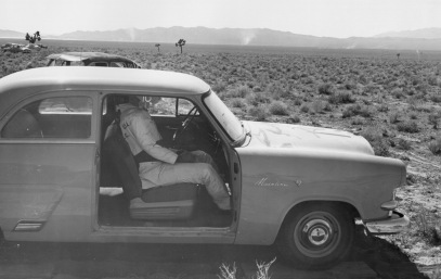 Vintage car in desert. Actually vehicle with mannequin in. Nevada nucelar testing site. (USPD. by Nat.Nuclear Security Adm./Pub. date,/Commons.wikimedia.org)