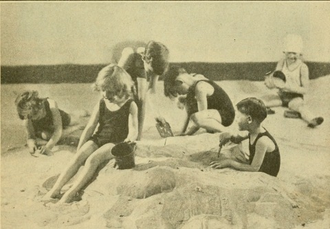 Children playing at the beach in the sand ( 1929 Health book./USPD pub.date/Commons.wikimedia.org)