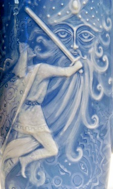 Warrior in battle with large supernatural being. Russian fairly tale Rusian and Lyudmila. Porcelain relief on cofee pot by Bystrushkin (image: Soli 1705 cr released/Commons.wikimedia.org)