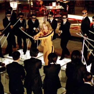 Sword fight scene from KIll Bill 2. The bride surrounded by the Crazy 88 (ScreenshotKill Bill wiki Fandom)