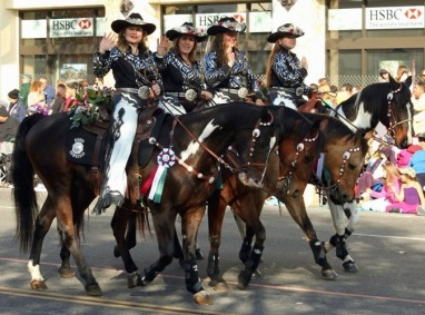 Cowgirls on parade. Cowgirls in fancy parade dress on horses with western saddles (Norco Cowgilrs Rodeo drill teamPrayito/Commons.wikimedia.org)