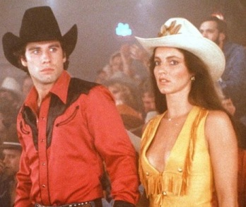 Nervous cowboy couple. Travolta and Winger in Urban Cowboy screenshot )