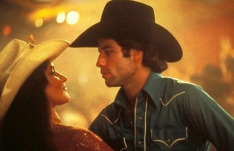 Cowboy and cowgirl gazing into each other's eyes. (Screenshot. Urban Cowboy)