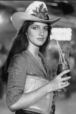 fancy cowgirl at nightclub/ Pam from Urban Cowboy film (image screenshot/tumbir)