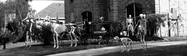Halloween yard decorations with skeletons and ghostly horse pulling hearse (© image copyrighted, no permissions given, all rights reserved)