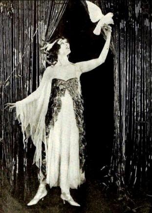 "Vintage dressed woman with white bird. Silent film star Elsie Ferguson in ""Eyes of the Soul"". Film Fun, Aug 1919. (USPD. pub.date, artist life/Commons.wikimedia.org)"