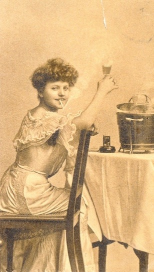 Vintage postcard with woman smoking and drinking at New Years party (1907 Skanderborg historic archives (USPD. pub.date, artist life/Common.wikimedia.org)