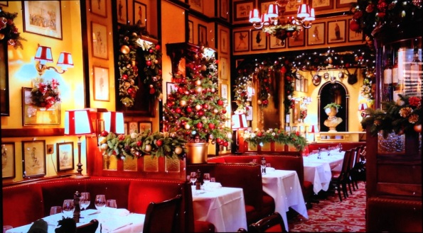 Cozy holiday restaurant scene with Christmas decorations and elegant tables. (© image. Copyrighted, all rights reserved. NO permissions granted)