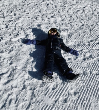 """Kid sprawled in snow.""""The snow is too hard and my legs are too tired"""" (© image copyrighted, all rights reserved no permissions given)"""